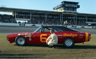 Charlie glotzbach kneels next to his #6 Cotton Owens Dodge for photos in February 1969, prior to the 1969 Daytona 500.